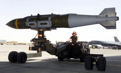 OPERATION IRAQI FREEDOM -- A weapons loader prepares a GBU-31 joint direct attack munition for a mission at a forward-deployed location.  Smart bombs like the JDAM have comprised 80 percent of the munitions used during this operation.  (U.S. Air Force photo by Staff Sgt. Jessica Kochman)